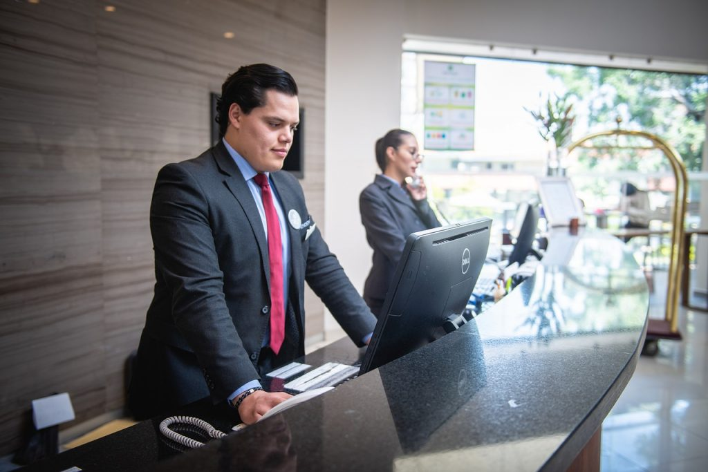 receptionist, man, hotel